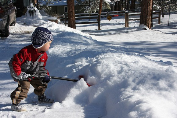 Little Boy Shovelling Snow